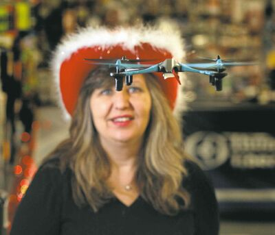 Eliminator-RC co-owner Laurrie Gobeil keeps a close eye on a drone in her store.