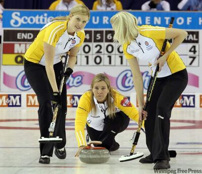 Manitoba skip Cathy Overton-Clapham (centre) delivers a rock as second Leslie Wilson (left) and lead Raunora Westcott prepare to sweep during the afternoon draw against Quebec at the 2011 Tournament of Hearts in Charlottetown, PEI on Monday Feb. 21, 2011.