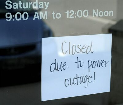 A closed sign is placed on the door at Community Bank on Saturday, June 30, 2012 in Staunton, Va. Violent storms swept across the eastern U.S., killing at least nine people and knocking out power to hundreds of thousands on a day that temperatures across the region are expected to reach triple-digits. (AP Photo/The News Leader, Pat Jarrett)
