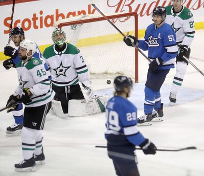 Winnipeg Jets' Bryan Little (18), Patrik Laine (29) and Mark Scheifele (55) celebrate after Laine scored on Dallas Stars' goaltender Ben Bishop (30) during third period NHL hockey action in Winnipeg, Monday, March 25, 2019. Trevor Hagan / The Canadian Press