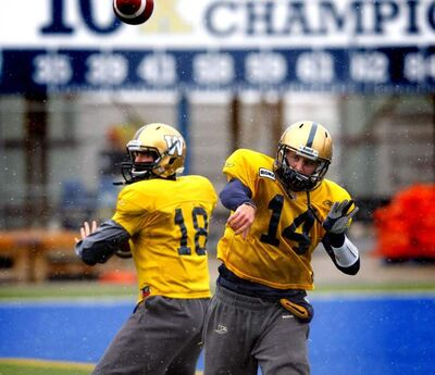 Bomber quarterbacks Justin Goltz (left) and  Joey Elliott practise today.