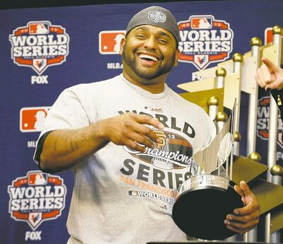 BELOW: 'Kung Fu Panda' Pablo Sandoval is all smiles after accepting the World Series MVP trophy.
