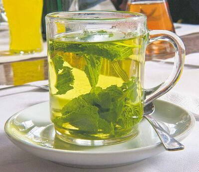 Peppermint  contains  menthol which settles an upset stomach. Make a quick, invigorating tea by adding fresh peppermint leaves to boiling water.
