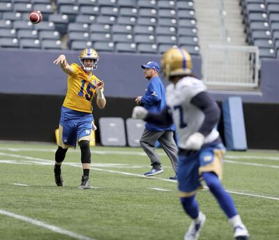 Winnipeg Blue Bombers' Matt Nichols (15) fires a pass to Christopher Normand (37) during training camp, Sunday, May 28, 2017.</p>