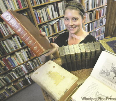 Aimee Peake, manager of Bison Books, holds the first edition of Charles Dickens' Pickwick Papers, which will set you back $7,000 at the book fair.