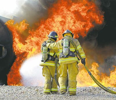 Firefighting students douse flames at the Manitoba Emergency Services College in Brandon.