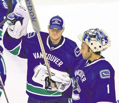Darryl Dyck / the canadian press archivesCory Schneider (left) may not be sharing ice time with Roberto Luongo for long.