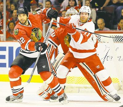 Nam Y. Huh / the associated press archivesDetroit�s Daniel Cleary (right) and Chicago defenceman Michal Rozsival battle for room during Game 1 of their NHL Western Conference semifinal.