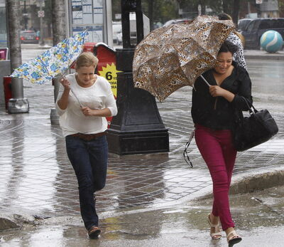 The weather was windy and wet for pedestrians on Portage Avenue Friday.