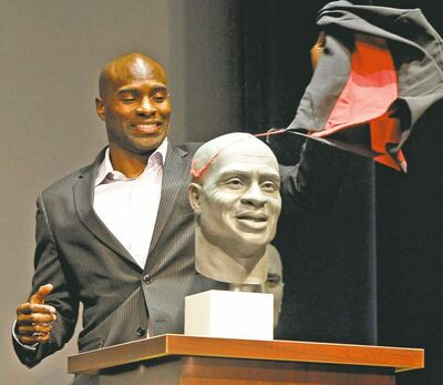 WAYNE GLOWACKI / WINNIPEG FREE PRESSThe one and only Milt Stegall unveils his bust at a Canadian Football Hall of Fame ceremony Friday. Milt would have preferred a statue, but...