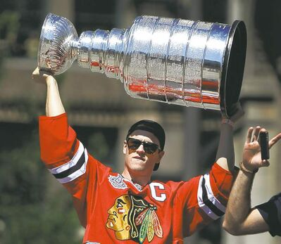 Jonathan Toews holds aloft the Stanley Cup during Friday's victory parade.