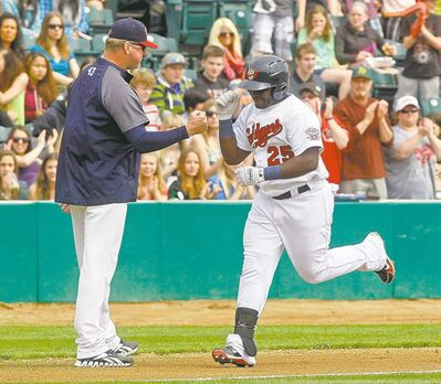 Goldeyes manager Rick Forney congratulates Leonard Davis after a first-inning dinger.