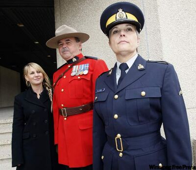 Marissa Freed with award-winning new RCMP uniforms, worn by Sgt. Line Karpish and Sgt. Robert Cooke.