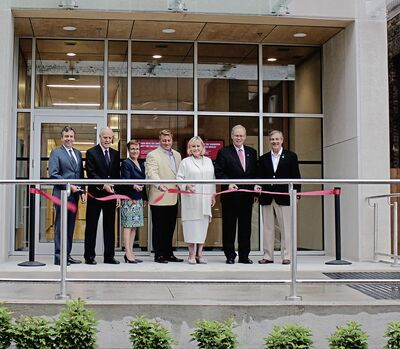 From left to right: Brian Daly, Jim MacDonald, Annette Trimbee, Tom Schock, Louise Leatherdale, Sandy Riley and Jim Richardson are pictured at the ribbon cutting for the University of Winnipeg's new Leatherdale Hall.