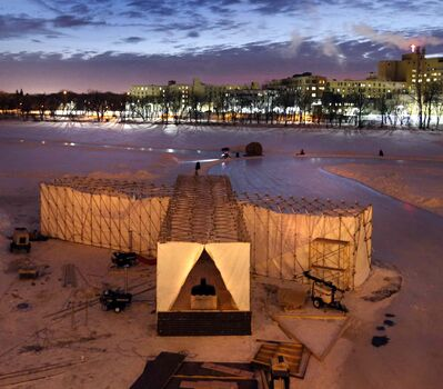 The sun rises Thursday morning behind the RAW:almond winter fine dining experience structure on the frozen Assiniboine River where it meets the Red River. The structure, designed this year by UK architects OS31, is open until Feb. 11.
