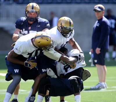 Bombers Pierre-Luc Labbe (top left) and Chris Garrett (middle) try to break up a scuffle between Quintin McCree (bottom left) and Jameze Massey as head coach Tim Burke looks on.