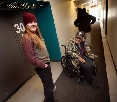 "Jonah, a resident at the Bell Hotel where the Main Street Project works a ""Harm Reduction"" program, visits with a pair of other residents at the Bell."