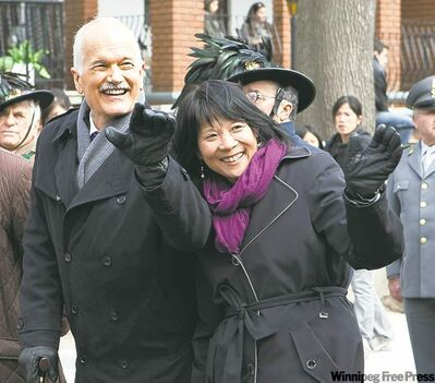 Jack Layton and wife Olivia Chow walk in the Via Dolorosa procession on Good Friday in Toronto.