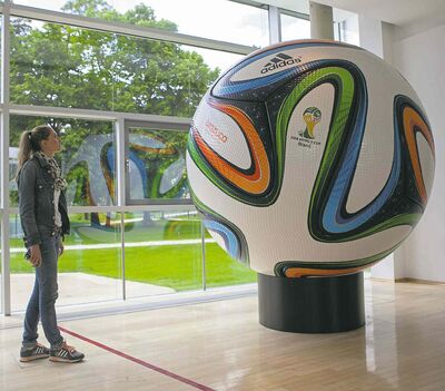 Germany's jersey and the official World Cup soccer ball are on display at Adidas's Herzogenaurach, Germany headquarters.