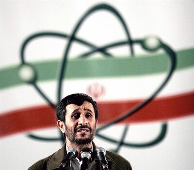 TO GO WITH STORY IRAN NUCLEAR -FILE- In this April 9, 2007, file photo, Iranian President Mahmoud Ahmadinejad speaks at a ceremony in Iran's nuclear enrichment facility in Natanz, south of capital Tehran, Iran. Technicians upgrading Iran's main uranium enrichment facility have tripled partial or full installations of high-tech machines that could be used in a nuclear weapons program to more than 600 since starting their work three months ago, according to diplomats who demanded anonymity because they said they are not authorized to disclose the information, Wednesday April 17, 2013. (AP Photo/Hasan Sarbakhshian, File)