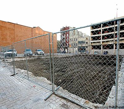 Empty lot to be developed for studio parking.