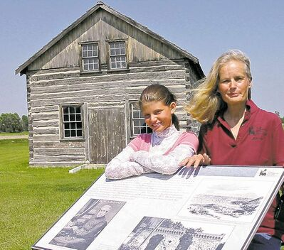 Tour guides  Melanie Thornberg and granddaughter Addy at  the Gingras Trading Post State Historic Site near Walhalla, N.D.