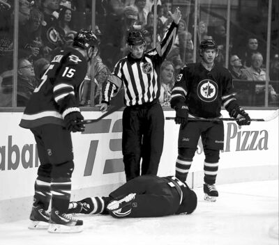 TREVOR HAGAN / WINNIPEG FREE PRESSThere were a few long, scary moments after Winnipeg Jets defenceman Jacob Trouba crashed headfirst into the end boards.