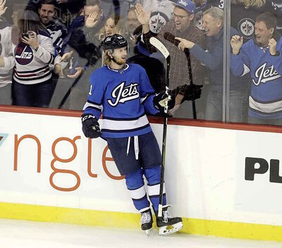 <p>Jets forward Kyle Connor celebrates after scoring in Tuesday&rsquo;s game against the Blackhawks. Connor finished the night with two goals, giving him three in the past two games.</p>