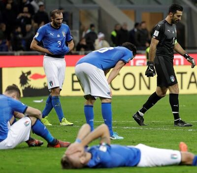 FILE - In this Nov. 13, 2017, file photo, Italian players react to their elimination at the end of the World Cup qualifying play-off second leg soccer match againstd Sweden, in Milan, Italy. Four-time champion Italy will be watching from home for the first time since 1958. (AP Photo/Luca Bruno, File)