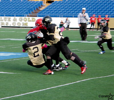 The Valour Patriots defence stands its ground in the MMFA bantam championship game against the St. Vital Mustangs.