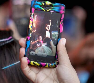 A girl in the crowd shoots video of Carly Rae Jepsen  on stage at the Red River Ex on Saturday afternoon.