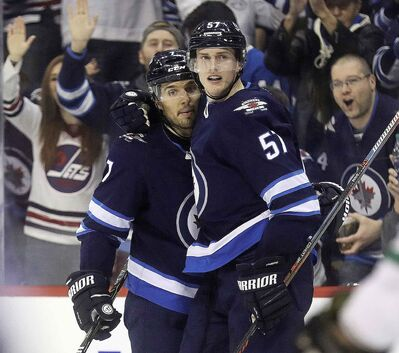 Winnipeg Jets' Ben Chiarot, left, and Tyler Myers have also seen an uptick in ice time since Big Buff went down.