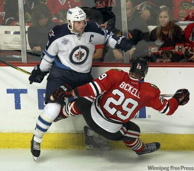 Jets captain Andrew Ladd (above left) and his linemates Bryan Little and Blake Wheeler have been held pointless in two games so far.
