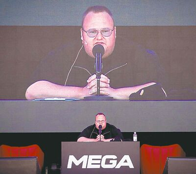 """Indicted Megaupload founder Kim Dotcom practices a speech before the launch of a new file-sharing website called """"Mega"""" at his Coatesville mansion in Auckland, New Zealand, Sunday, Jan. 20, 2013. The colorful entrepreneur unveiled the site ahead of a lavish gala and press conference on the one-year anniversary of his arrest on racketeering charges related to his now-shuttered Megaupload file-sharing site."""