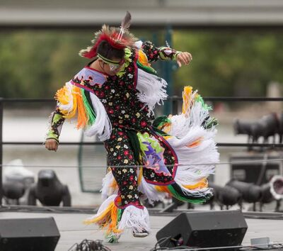 Dancers from the Aboriginal School of Dance perform on a barge on the Red River earlier this month as part of BargeFest.