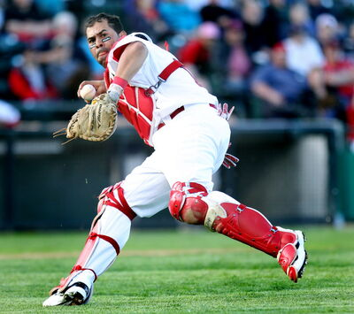 Winnipeg Goldeyes catcher Luis Alen grabs an errant ball off the infield and throws out Sioux City Explorer Andres Perez at first on Monday at Shaw Park.