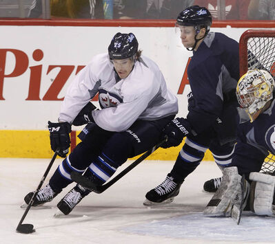 Jets defenceman Zach Redmond (left), nearly fully recovered from a horrifying injury in February, is chased by James Wright at the team's optional practice last week.