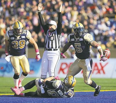Winnipeg Blue Bombers' Chad Simpson (5), right, celebrates after scoring a touchdown against the Calgary Stampeders' during the first half of CFL football action at Canad Inns Stadium, Saturday, October 13, 2012. (TREVOR HAGAN/WINNIPEG FREE PRESS)