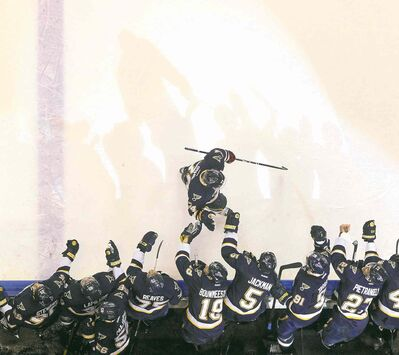 Chris Lee / St. Louis Post-Dispatch / MCTT.J. Oshie of the St. Louis Blues is congratulated by teammates after scoring a shootout goal against the Winnipeg Jets Saturday afternoon in St. Louis.