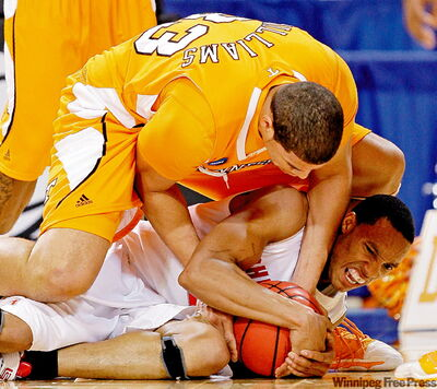 Ohio State's Evan Turner and Tennessee's Brian Williams (33) fight for the ball during the first half in St. Louis Friday.