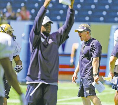 Winnipeg head coach Tim Burke (right) said his secondary's work against Hamilton Friday night 'looked like crap.'