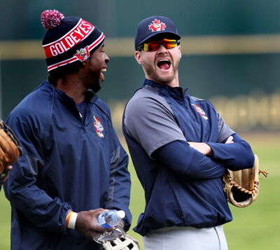 Goldeyes outfielders Ray Sadler (left) and Josh Mazzola had time for a little socializing before the team left today on an 18-day road trip to start the season.