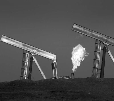 Natural gas is burned off at well sites east of Williston, N.D., in the heart of the Bakken oil region.
