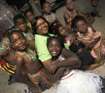 PHIL HOSSACK / WINNIPEG FREE PRESS</p><p>Florence Okwudili is surrounded by members of the Umunna Igbo Association Dancers in her basement where the group rehearses.</p>