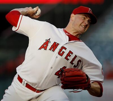FILE - In this July 10, 2018, file photo, Los Angeles Angels starting pitcher Garrett Richards delivers to a Seattle Mariners batter during the first inning of a baseball game in Anaheim, Calif. Richards says on Twitter that he's joining the rebuilding San Diego Padres. Multiple reports indicate the right-hander has agreed to a $15 million, two-year contract. Richards had reconstructive elbow surgery in July while with the Los Angeles Angels. Neither the Padres nor Richards' agency would confirm the deal Thursday night, Nov. 29. AP Photo/Alex Gallardo, File)