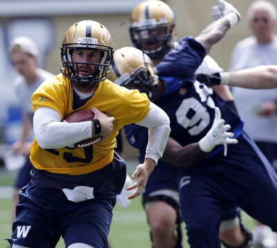 Max Hall pulls down the ball and goes for a run at  Blue Bomber training camp earlier in June.