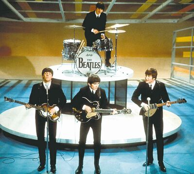 The Beatles perform on the Ed Sullivan Show on Feb. 9, 1964.