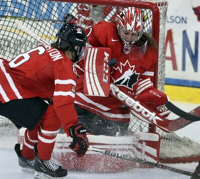 Canada's goaltender Shannon Szabados (1) makes a save on a Team Sweden shot as teammate Jaya Johnston (16) looks on during second period IIHF Women's World Hockey Championship exhibition game action Pembroke, Ontario Saturday March 30, 2013. The IIHF Women's World Hockey Championship starts in Ottawa on Tuesday. THE CANADIAN PRESS/Fred Chartrand