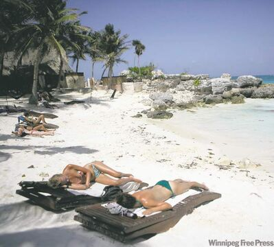 Tourists sunbathe near Tulum along Mexico's Riviera Maya Caribbean coast.