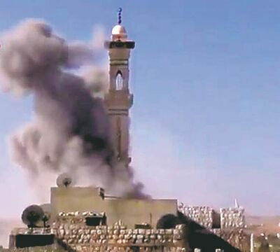 Ugarit News / The Associated PressIn this image taken from video, smoke rises from  a minaret of a mosque in Idlib, Syria, on Wednesday.